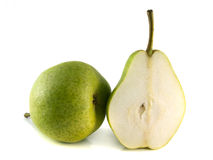 Ripe green pear with half on white background. Stock Images