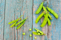 Ripe green peas in pod on shabby background Stock Images