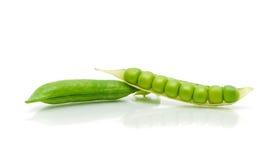 Ripe green peas on a white background with reflection. Horizontal photo Stock Photo