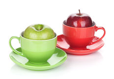 Ripe green and red apple in tea cup Stock Image