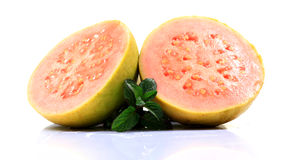 Ripe guava. Pink colored cut guava on white background Stock Photography