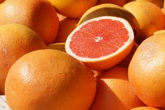 Ripe half of the grapefruit is on the counter at the fruit market in Spain Royalty Free Stock Photography