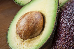 Ripe halved avocado on plate. Closeup Royalty Free Stock Photography