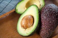 Ripe halved avocado on plate. Closeup. Royalty Free Stock Image