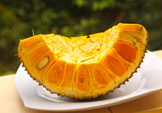 Ripe jack fruit cut section on plate Stock Image