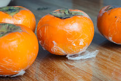 Ripe japan persimmons Stock Photography