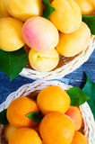 Ripe juicy apricots. In a basket on a wooden background Stock Images
