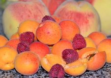 Ripe juicy apricots and peaches, summer harvest stock photo
