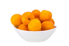 Ripe juicy apricots in a plate on a white background Stock Photography