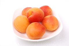 Ripe and juicy apricots on white Royalty Free Stock Image