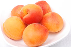 Ripe and juicy apricots on white Royalty Free Stock Photography