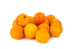 Ripe juicy apricots on a white background Royalty Free Stock Photos