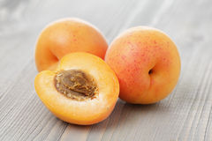 Ripe juicy apricots on wooden table Stock Photography