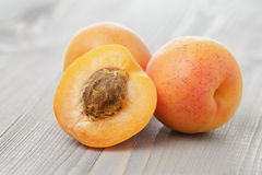 Ripe juicy apricots on wooden table Royalty Free Stock Image