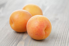 Ripe juicy apricots on wooden table Royalty Free Stock Photography