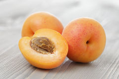 Ripe juicy apricots on wooden table Stock Photo