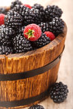 Ripe juicy berries blackberry and raspberry in rustic style Royalty Free Stock Photos