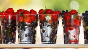 Ripe and juicy berries.summer gifts. Royalty Free Stock Photo