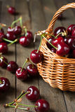 Ripe juicy cherries in a basket on the table, Stock Photography