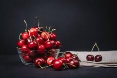 Ripe juicy cherries in a glass on a dark background. Ripe juicy cherries in a glass Stock Photography