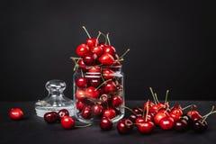 Ripe juicy cherries in a glass on a dark background. Ripe juicy cherries in a glass Stock Images