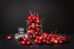 Ripe juicy cherries in a glass on a dark background. Ripe juicy cherries in a glass Royalty Free Stock Photos