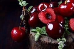 Free Ripe Juicy Cherries On Tree Stump Royalty Free Stock Image - 154104516