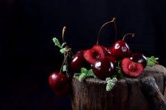 Free Ripe Juicy Cherries On Tree Stump Stock Photos - 154288673