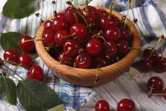 Ripe juicy cherries in a wooden bowl closeup. horizontal Royalty Free Stock Photo