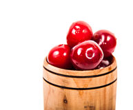 Ripe juicy cherries in a wooden cup Royalty Free Stock Photography