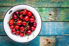 Ripe juicy cherry in an old bowl Stock Image