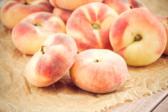 Ripe juicy chinese flat peaches Royalty Free Stock Images