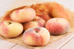 Ripe juicy chinese flat peaches Stock Photo