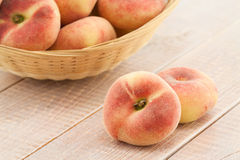 Ripe juicy chinese flat peaches Stock Images