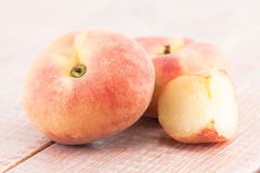 Ripe juicy chinese flat peaches Stock Photos