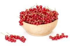 Ripe juicy currant branches in a plate on white table. On a white background Stock Photo