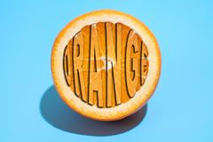 Ripe juicy delicious orange on blue background. Healthy eating and dieting concept.  stock illustration