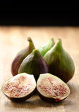 Ripe juicy figs on a wood board Stock Images