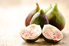 Ripe juicy figs on a wood board Royalty Free Stock Photography