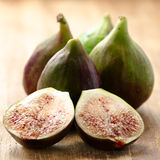 Ripe juicy figs on a wood board Royalty Free Stock Photo