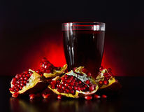 Ripe juicy fruit of the broken pomegranate Stock Photo