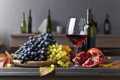 Ripe juicy grape and glass of red wine Stock Images