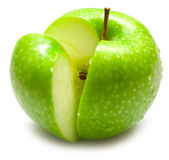 Ripe juicy green apple. The ripe juicy green apple covered by drops of water. Isolation on white, shallow DOF Royalty Free Stock Photography