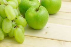 Ripe and juicy green grapes and apple Stock Photo