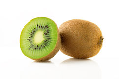 Ripe and juicy kiwi fruit and its parts. On a white background Royalty Free Stock Photos