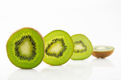 Ripe and juicy kiwi fruit and its parts. On a white background Stock Photo