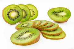 Ripe and juicy kiwi fruit and its parts. On a white background Royalty Free Stock Photography