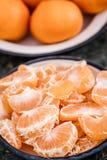 Ripe Juicy Mandarin Fruits in Enamel Plates on Blue Background Royalty Free Stock Photo