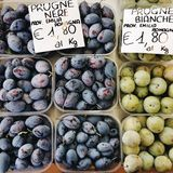 Organic plums at the market stock image