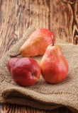 Ripe juicy organic red pears on the wooden table Stock Photos